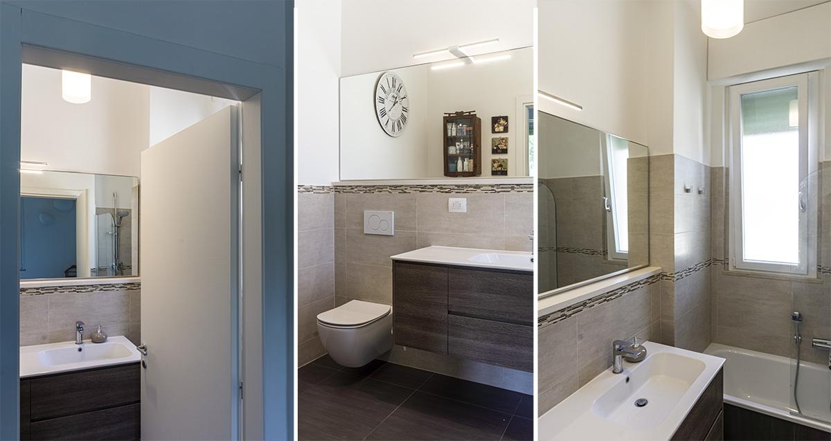 CASA MP - Dettaglio del bagno con vasca, lavabo e pavimento in ceramica colori scuri, pareti toni del beige con greca in mosaico - Tommaso Vecci